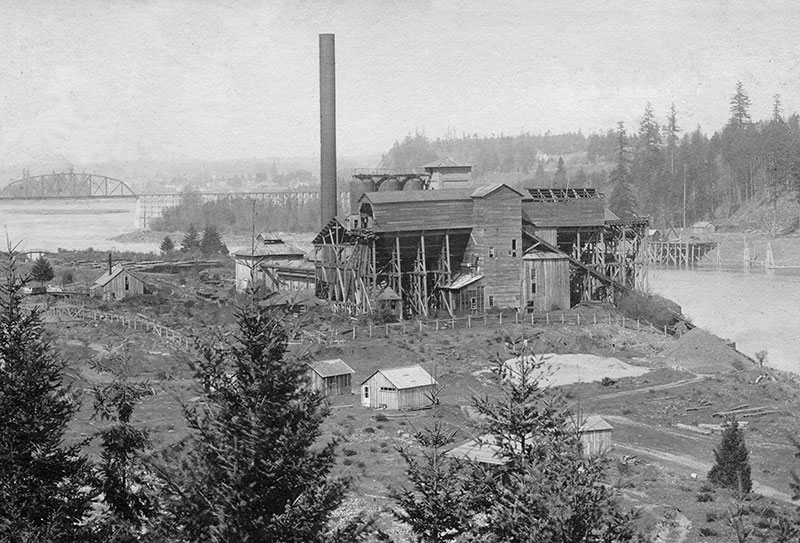 The giant wooden stock houses of the Oswego iron works were destroyed by fire on August 5, 1920. Photo courtesy of Lake Oswego Public Library.