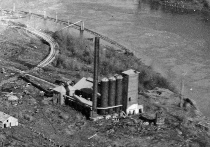 Aerial view of the second iron works in 1928, a few months before they were demolished. Detail of photo from the Lake Oswego Public Library.
